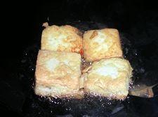 臭豆腐烩毛豆的家常做法